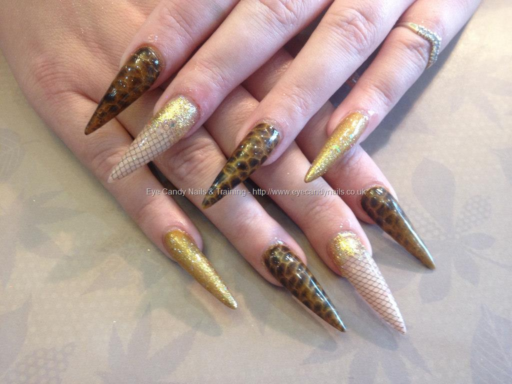 Dev Guy Stiletto Nails With Gold And Black Snake Skin Affect And